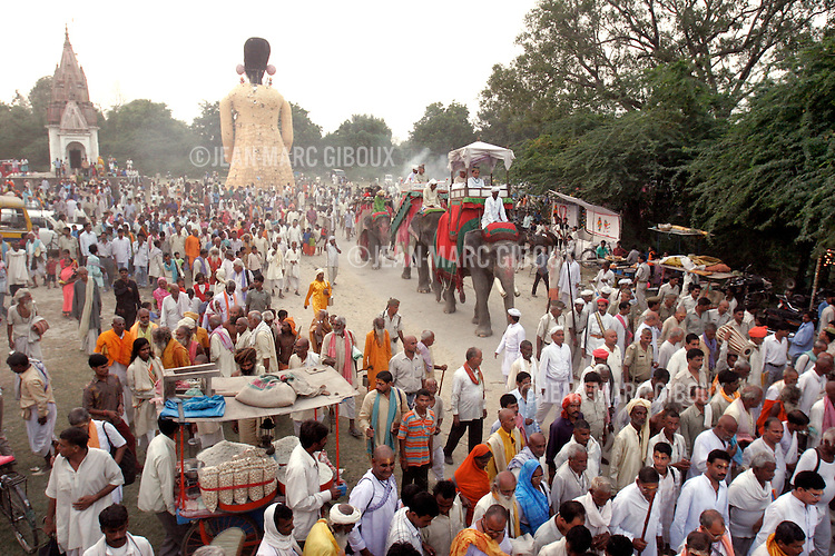 .RAMNAGAR, UTTAR PRADESH, INDIA - OCTOBER 5, 2005 : Actors, the audience and the Maharaja of Banares move from one stage location to another during the performance of the 19th episode of the Ramlila in Ramnagar on October 5, 2005. The Ramlila is the play of the Hindu scripture 'the Ramayana' which depict the struggle of the god Ram and his fight against the Demon God Ravana, like the struggle of good against evil. The Ramlila of Ramnagar has been organized by the Maharaja of Benares since the early 1800s and is still its most authentic rendition, a reference to other Ramlilas. It last for 31 days and is staged over a 10 square mile area. It is the largest play to be produced in the world .(Photo by Jean-Marc Giboux)