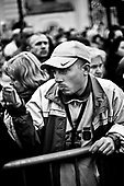 Warsaw 04/2010 Poland<br /> People mourning the tragic death of President Lech Kaczynski and his wife in front of the presidential residence.<br /> on picture: young man takes picture by cell phone<br /> Photo: Adam Lach / Napo Images for The New York Times<br /> <br /> Zaloba po tragicznej smierci Prezydenta Lecha Kaczynskiego i jego malzonki,ul. Krakowskie Przedmiescie przed Palacem Prezydenckim.<br /> na zdjeciu: mlody czlowiek robi zdjecia telefonem komorkowym<br /> Fot: Adam Lach / Napo Images dla The New York Times