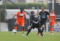 Pictured L-R: Nathan Dyer of Swansea against Jack Lewis and Lee Trundle of Neath. Saturday 17 July 2011<br />