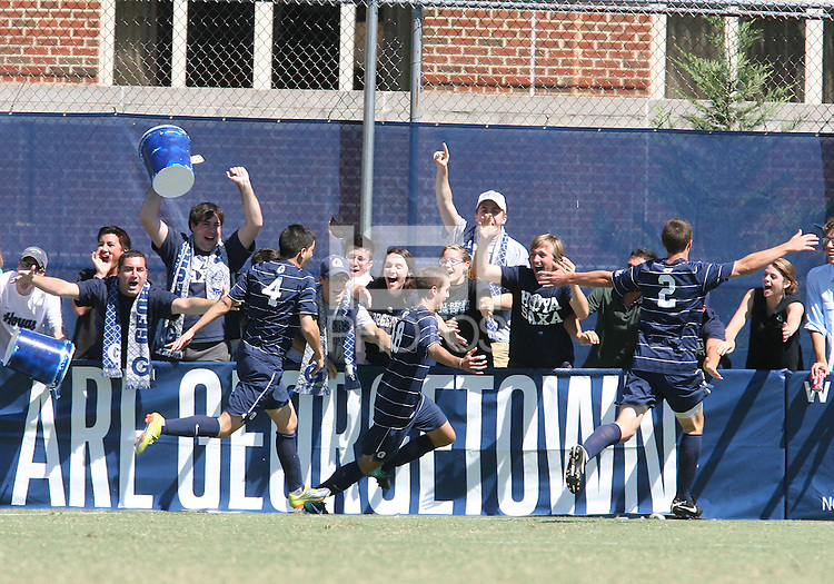 Steve Neumann #18 with Joey Dillon #2 and Seth C'deBaca #4 of Georgetown University after he had scored during an NCAA match against Michigan State at North Kehoe Field, Georgetown University on September 5 2010 in Washington D.C. Georgetown won 4-0.