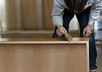 Hiromitsu Tanaka, 38, paints stainer on kiri-tansu furniture at Kamo Kiri-dansu maker Asakura Kagu in Niigata City, Niigata Prefecture Japan on Feb. 21, 2017. ROB GILHOOLY PHOTO