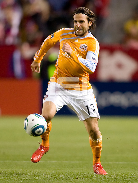 Houston Dynamo defender Michael Chabala (17) charges the ball. The Houston Dynamo defeated CD Chivas USA 2-0 at Home Depot Center stadium in Carson, California on Saturday May 8, 2010.  .