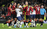 Players from both sides clash with Tottenham's Moussa Sissoko and Bournemouth's Jefferson Lerma being held back by their team mates during the Premier League match at the Tottenham Hotspur Stadium, London. Picture date: 30th November 2019. Picture credit should read: Paul Terry/Sportimage
