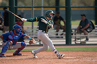 Oakland Athletics catcher Skyler Weber (11) follows through on his swing during a Minor League Spring Training game against the Chicago Cubs at Sloan Park on March 13, 2018 in Mesa, Arizona. (Zachary Lucy/Four Seam Images)