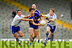 Daniel O'Sullivan and Aidan Walsh Saint Mary's in action against Liam Kearney Spa after losing the Intermediate final at Fitzgerald Stadium on Sunday.