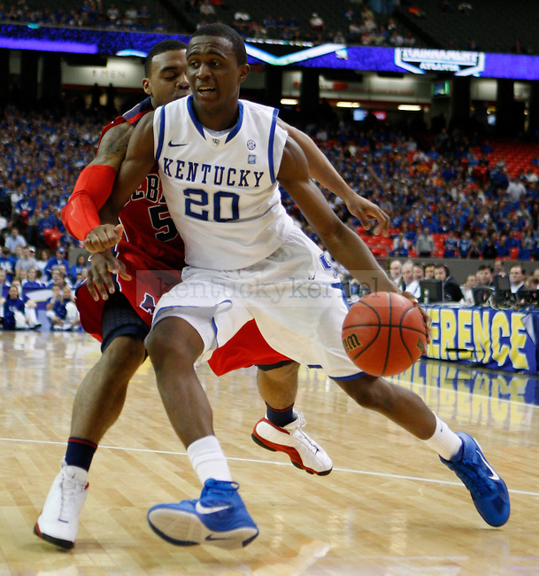 ATLANTA, GA. - Doron Lamb being guarded by an Ole Miss player in the second round of the 2011 SEC Men's Basketball Tournament, played at the Georgia Dome, Friday, March 11, 2011.  Photo by Latara Appleby | Staff