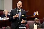 Nevada Senate Minority Leader Aaron Ford, D-Las Vegas, speaks on the Senate floor at the Legislative Building in Carson City, Nev., on Tuesday, April 21, 2015. <br /> Photo by Cathleen Allison