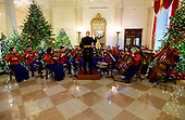 """The 2018 White House Christmas decorations, with the theme """"American Treasures"""" which were personally selected by first lady Melania Trump, are previewed for the press in Washington, DC on Monday, November 26, 2018. The Marine Band performs in the Grand Foyer during the press preview of the White House Christmas decorations.  <br /> Credit: Ron Sachs / CNP"""