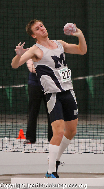 SPEARFISH, S.D. -- FEBRUARY 22, 2013 -- Heptathlon contender Dallas Hall of Colorado Mines participates in the men's shot put Friday morning during the 2013 RMAC Men's and Women's Track and Field Championships at the Donald Young Center on the campus of Black Hills State University.   (Photo by Richard Carlson/dakotapress.org)