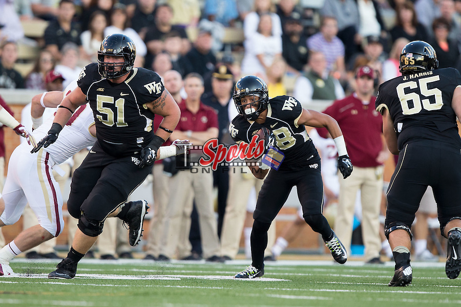 Jared Crump (88) of the Wake Forest Demon Deacons follows the block of Cory Helms (51) during second half action against the Boston College Eagles at BB&T Field on October 25, 2014 in Winston-Salem, North Carolina.  The Eagles defeated the Demon Deacons 23-17.  (Brian Westerholt/Sports On Film)