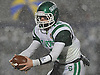 Seaford quarterback No. 12 Andrew Cain rolls to his left during the Nassau County varsity football Conference IV final against Locust Valley at Hofstra University on Thursday, Nov. 19, 2015. Locust Valley won by a score of 20-6.<br /> <br /> James Escher