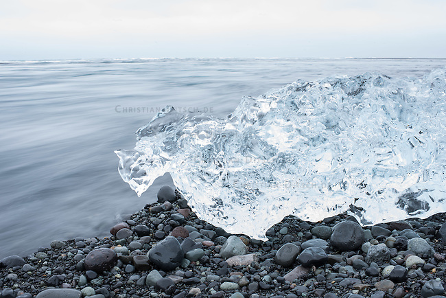 Ice from the Breidamerkurjoekull glacier. The ice floats from the glacier into the North Atlantic.<br /> Eis vom Breidamerkurjoekull-Gletscher am Meeresstrand. Das Eis treibt vom Gletscher mit dem Schmelzwasser in den Nordatlantik.<br /> 22.3.2016, Joekulsarlon<br /> Copyright: Christian-Ditsch.de<br /> [Inhaltsveraendernde Manipulation des Fotos nur nach ausdruecklicher Genehmigung des Fotografen. Vereinbarungen ueber Abtretung von Persoenlichkeitsrechten/Model Release der abgebildeten Person/Personen liegen nicht vor. NO MODEL RELEASE! Nur fuer Redaktionelle Zwecke. Don't publish without copyright Christian-Ditsch.de, Veroeffentlichung nur mit Fotografennennung, sowie gegen Honorar, MwSt. und Beleg. Konto: I N G - D i B a, IBAN DE58500105175400192269, BIC INGDDEFFXXX, Kontakt: post@christian-ditsch.de<br /> Bei der Bearbeitung der Dateiinformationen darf die Urheberkennzeichnung in den EXIF- und  IPTC-Daten nicht entfernt werden, diese sind in digitalen Medien nach &sect;95c UrhG rechtlich geschuetzt. Der Urhebervermerk wird gemaess &sect;13 UrhG verlangt.]