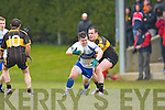 Stephen Bartlett Castleisland Desmonds goes past Mike McCarthy Currow during their Intermediatte Championship clash in Currow on Sunday