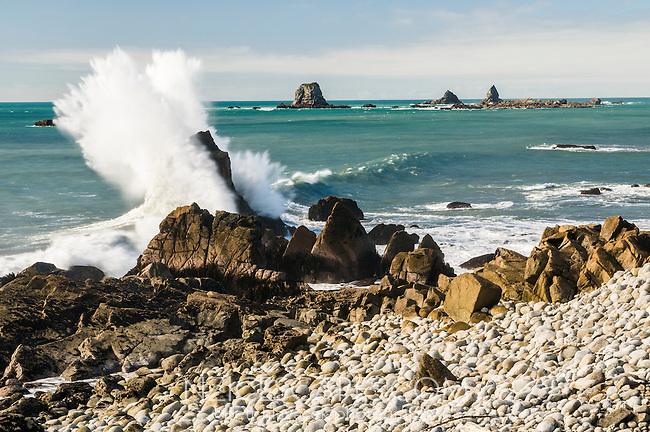 Crashing waves on rocks near Tauranga Bay near Westport, West Coast, Buller Region, New Zealand