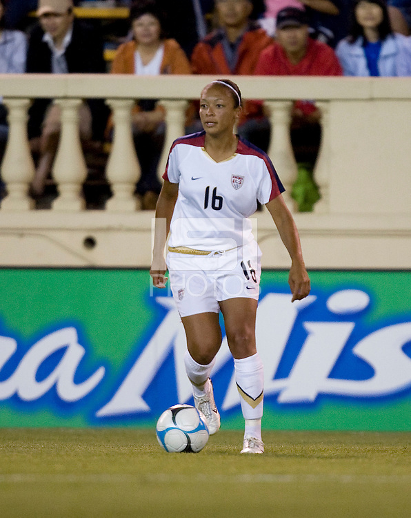 Angela Hucles controls the ball. USA defeated Japan 4-1 at Spartan Stadium in San Jose, CA on July 28, 2007.