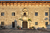 Facade of the Museo de las Casas Reales, or Museum of the Royal Houses, in the Colonial Zone of Santo Domingo, capital of the Dominican Republic, in the Caribbean. The museum was opened in 1973 to celebrate the history and culture of the Spanish inhabitants of the colony, and is housed in a 16th century colonial palace originally serving as governor's office and Audiencia Real or Royal Court. Santo Domingo's Colonial Zone is listed as a UNESCO World Heritage Site. Picture by Manuel Cohen