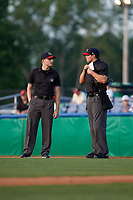 Umpires Tyler Witte (L) and Jesse Busch (R) during a NY-Penn League game between the State College Spikes and Batavia Muckdogs on July 2, 2019 at Dwyer Stadium in Batavia, New York.  Batavia defeated State College 1-0.  (Mike Janes/Four Seam Images)