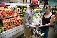 Caucasian couple shopping for produce at Mana Foods grocery store in Paia, Maui