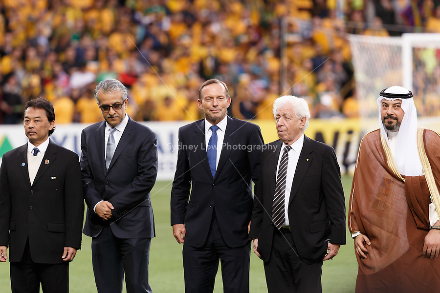 Officials and VIP including the prime minister of Australia Tony Abbott and Frank Lowy the chairman of the Football Federation of Australia take part in the opening ceremony for match 1 of the 2015 AFC Asian Cup at the Melbourne Rectangular Stadium on 9 January 2015.