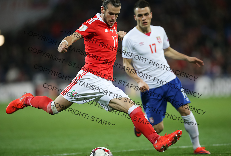 (copyright &amp; photo: STARSPORT)<br /> 12.11.16 - Wales v Serbia, FIFA World Cup Qualifier 2018 - Gareth Bale of Wales fires a shot as Filip Kostic of Serbia closes in