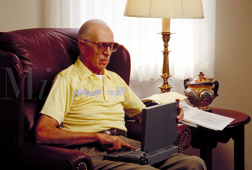 Senior man with laptop computer.