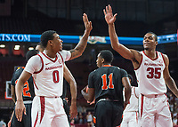 NWA Democrat-Gazette/BEN GOFF @NWABENGOFF <br /> Desi Sills (0) and Reggie Chaney of Arkansas high five after a play in the first half vs Tusculum Friday, Oct. 26, 2018, during an exhibition game in Bud Walton Arena in Fayetteville.