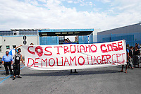 Roma   5 Luglio 2005  .Manifestazione  di Action  al Cpt di  Ponte Galeria per chiederne la chiusura.Rome July 5 th 2005    .Demonstration of Action to the Cpt  Ponte Galeria's Centre of identification and expulsion for illegal  immigrants to ask its closing.The banner reads: We build Houses  .We demolish lager