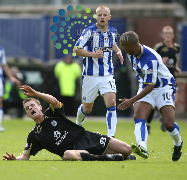 St Mirren Stephen McGinn(4)  is fouled by Mehdi Taouil(10)  during the Kilmarnock v St Mirren Clydesdale Bank Scottish Premier League at Rugby Park 29/08/09....Picture by Ricky Rae/ Universal News & Sport (Scotland).