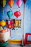 VIETNAM, Hoian, Paper Lanterns Decorations hanging in front of a blue Wall