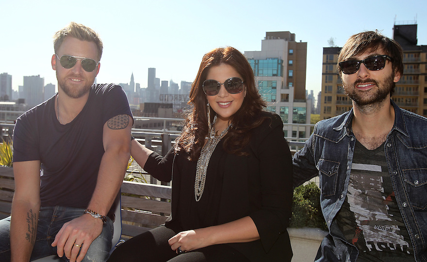 Charles Kelley left, Hillary Scott and Dave Haywood of Lady Antebellum pose for a photo on the roof of the JetBlue building at the Live From T5 Concert Series, on Thursday, May 2, 2013 in Queens, New York. (Photo by www.soulb.photoshelter.com)