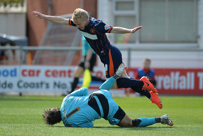 Fleetwood Town's Chris Maxwell saves the ball from Blackpool's Mark Cullen's early shot<br /> <br /> Photographer Dave Howarth/CameraSport<br /> <br /> Football - The Football League Sky Bet League One - Fleetwood Town v Blackpool - Saturday 23rd April 2016 - Highbury Stadium - Fleetwood  <br /> <br /> &copy; CameraSport - 43 Linden Ave. Countesthorpe. Leicester. England. LE8 5PG - Tel: +44 (0) 116 277 4147 - admin@camerasport.com - www.camerasport.com