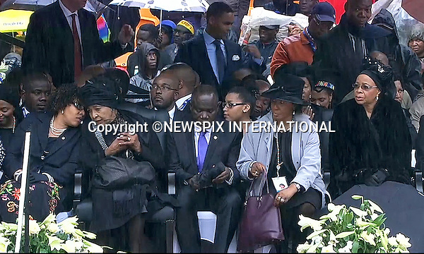 WINNIE MANDELA, NELSON'S DAUGHTER MAKAZIWE MANDELA AND NELSON'S WIDOW GRACA MACHEL(right)<br /> NELSON MANDELA MEMORIAL<br /> The nation mourns Nelson Rolihlahla Mandela Memorial Service, FNB Stadium, Johannesburg, South Africa<br /> Mandatory Credit Photo: &copy;NEWSPIX INTERNATIONAL<br /> <br /> **ALL FEES PAYABLE TO: &quot;NEWSPIX INTERNATIONAL&quot;**<br /> <br /> IMMEDIATE CONFIRMATION OF USAGE REQUIRED:<br /> Newspix International, 31 Chinnery Hill, Bishop's Stortford, ENGLAND CM23 3PS<br /> Tel:+441279 324672  ; Fax: +441279656877<br /> Mobile:  07775681153<br /> e-mail: info@newspixinternational.co.uk