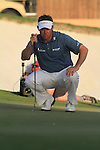Dubai World Championship Golf. Earth Course,.Jumeirah Golf Estate, Dubai, U.A.E...Lee Westwood lines up his putt on the 18th green during the third round of the Dubai World Golf championship..Photo: Fran Caffrey/www.golffile.ie...