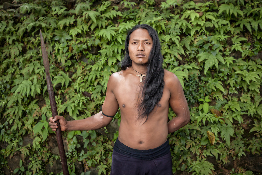 """A Wengding villager armed with spear. The Wa, which literally means """"mountain dwellers"""", is the hilltribe that inhabit the Sino-Burmese. Known as one of the last headhunting tribe until mid-twentieth century, their population in both countries now approximately no more than one million. In the homogenous society of modern China, Wa is one of more than 50 officially state-recognized ethnic minorities. They can be found around the southwestern corners of Yunnan province."""