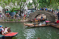 Suzhou, Jiangsu, China.  Tourists Boating on a Canal in Tongli Ancient Town near Suzhou, a popular weekend tourist destination.