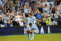 Graham Zusi (8) midfielder Sporting KC lifted by Matt Besler celbrate a goal... Sporting Kansas City defeated Portland Timbers 3-1 at LIVESTRONG Sporting Park, Kansas City, Kansas.