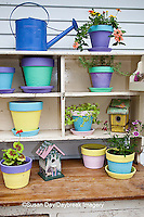 63821-202.14 Potting bench with containers, birdhouses and flowers in spring, Marion Co. IL