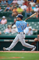 Tampa Bay Rays second baseman Andrew Velazquez (11) follows through on a swing during a Grapefruit League Spring Training game against the Baltimore Orioles on March 1, 2019 at Ed Smith Stadium in Sarasota, Florida.  Rays defeated the Orioles 10-5.  (Mike Janes/Four Seam Images)