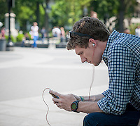 A park visitor listens to music in Washington Square Park in Greenwich Village in New York on Tuesday, May 21, 2013. . The temperature is expected to hit the high 80's this afternoon with a chance of spotty thunderstorms. (© Richard B. Levine)