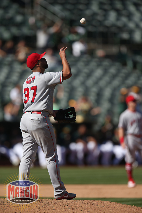 OAKLAND, CA - SEPTEMBER 20:  Francisco Arcia #37 of the Los Angeles Angels of Anaheim tosses a ball up in the air after giving up a home run while pitching against the Oakland Athletics during the game at the Oakland Coliseum on Thursday, September 20, 2018 in Oakland, California. (Photo by Brad Mangin)