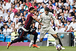 Alvaro Morata of Real Madrid competes for the ball with M M Dos Santos of SD Eibar during their La Liga match between Real Madrid CF and SD Eibar at the Santiago Bernabéu Stadium on 02 October 2016 in Madrid, Spain. Photo by Diego Gonzalez Souto / Power Sport Images