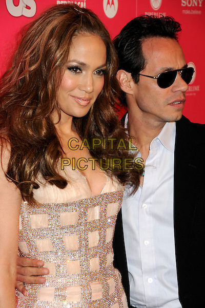 JENNIFER LOPEZ & MARC ANTHONY.US Weekly Hot Hollywood Style Issue Event held at Drai's at the W Hollywood Hotel, Hollywood, California, USA..April 22nd, 2010.half length dress j-lo pink diamante sparkly black suit jacket blue shirt sunglasses shades married husband wife blue shirt profile .CAP/ADM/BP.©Byron Purvis/AdMedia/Capital Pictures.