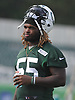 Lorenzo Mauldin #55 heads off the field after a day of New York Jets Training Camp at the Atlantic Health Jets Training Center in Florham Park, NJ on Wednesday, Aug. 9, 2017.
