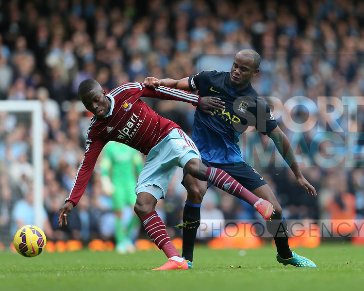 West Ham's Enner Valencia tussles with Manchester City's Vincent Kompany<br /> <br /> Barclays Premier League - West Ham United vs Manchester City - Upton Park - England - 25th October 2014 - Picture David Klein/Sportimage
