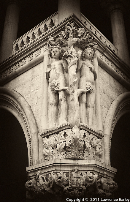 Beautifully rendered sculpture of Adam and Eve on a  capital of the Doge's Palace in St. Mark's square.  Just about every capital has a different carving on it.