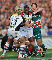 Leicester, England. Ugo Monye of Harlequins tackled  during the Aviva Premiership match between Leicester Tigers and Harlequins at Welford Road on September 22, 2012 in Leicester, England.
