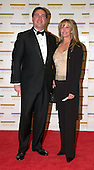 "Bo Derek and Charles Edelstein arrive at the Harry S. Truman Building (Department of State) in Washington, D.C. on December 4, 2004 for a dinner hosted by United States Secretary of State Colin Powell.  At the dinner six performing arts legends will receive the Kennedy Center Honors of 2004.  This is the 27th year that the honors have been bestowed on ""extraordinary individuals whose unique and abundant artistry has contributed significantly to the cultural life of our nation and the world"" said John F. Kennedy Center for the Performing Arts Chairman Stephen A. Schwarzman.  The award recipients are: actor, director, producer, and writer Warren Beatty; husband-and-wife actors, writers and producers Ossie Davis and Ruby Dee; singer and composer Elton John; soprano Joan Sutherland; and composer and conductor John Williams..Credit: Ron Sachs / CNP"