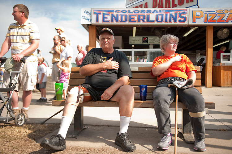 UNITED STATES - AUGUST 15:  Dave Carter, a Vietnam veteran, watches the Veteran's parade at the Iowa State Fair in Des Moines, Iowa.   (Photo By Tom Williams/Roll Call)