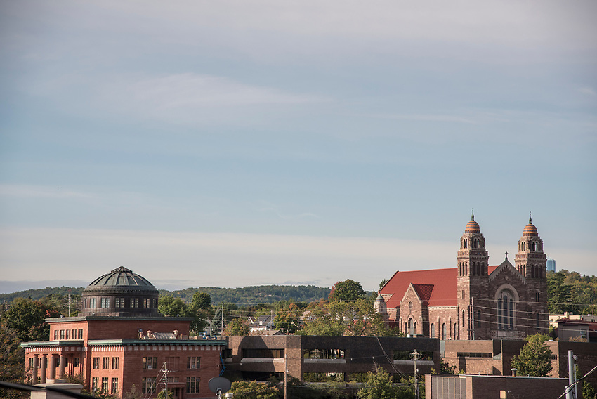 Downtown Marquette, Michigan featuring the dome of the Marquette County Courthouse, left, and St. Peter Cathedral, right.