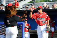 Batavia Muckdogs first baseman Carlos Lopez #36 high fives mascot Homer during introductions before a game against the Mahoning Valley Scrappers on June 21, 2013 at Dwyer Stadium in Batavia, New York.  Batavia defeated Mahoning Valley 3-2.  (Mike Janes/Four Seam Images)